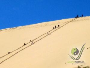 Climbing to Khongor Sand Dunes